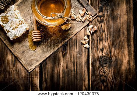 Sweet Honey In The Comb, Glass Jar With Nuts.