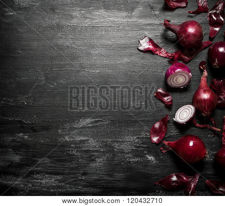 Red Onion . On Black Rustic Background.