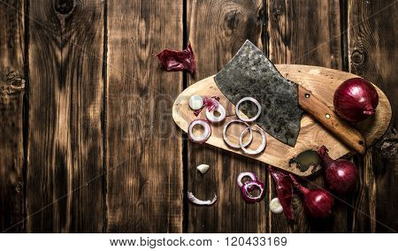 Sliced Red Onion And An Old Hatchet.