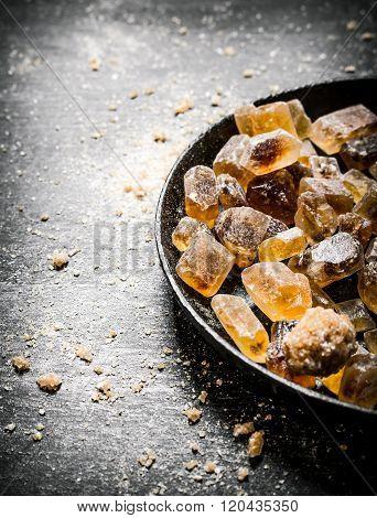 Crystal Brown Sugar. On Black Rustic Background.
