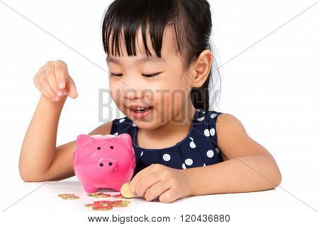 Asian Little Chinese Girl Putting Coins Into Piggy Bank