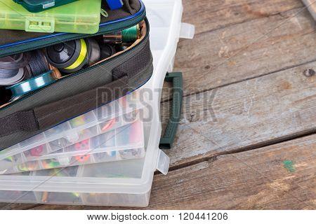 Fishing Tackles And Baits In Box And Bag