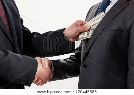 Giving A Bribe Into A Pocket
