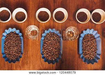 Perfect rows of containers with beans and ground coffee