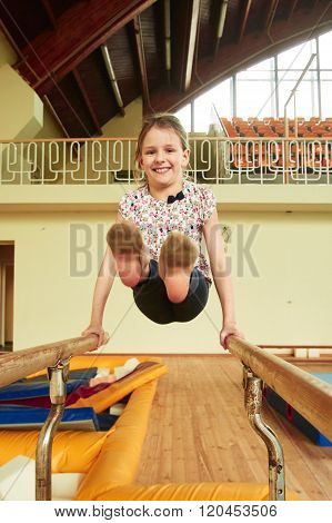 Children Athlete Train In Gymnastics Hall
