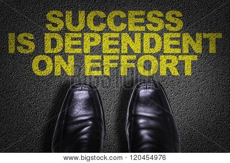Top View of Business Shoes on the floor with the text: Success is Dependent On Effort