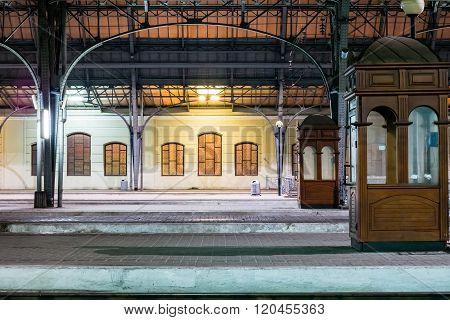 Passenger platform at night on the railway station.