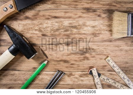 Tools on wooden table. background