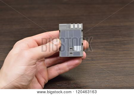 Hand Shows How To Recharge Battery