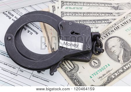 Handcuffs And Money With Sign – Money On Tax Form Background