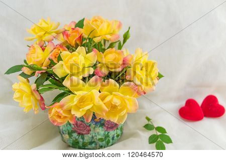 Yellow roses bouquet on a white silken sheet