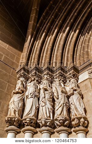 Close-up on the Apostles statues placed on the left side of the Evora Cathedral Portal in Portugal. Romanesque and Gothic architecture. UNESCO World Heritage Site.