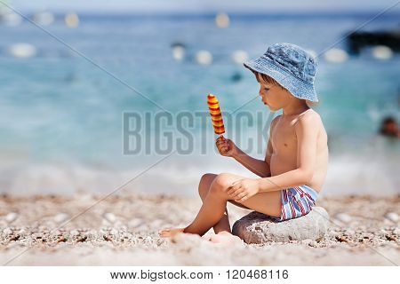 Sweet Little Child, Boy, Eating Ice Cream On The Beach