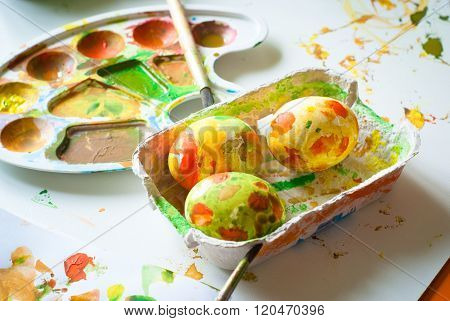 The abstract colored painted eggs for Easter.