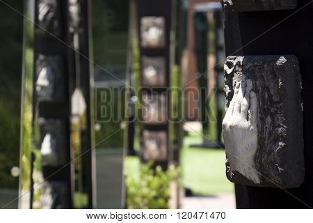 FAYETTEVILLE, NC - JUNE 28, 2015: Close up view of the Community Columns in the North Carolina Veterans Park that represent each of the states 100 counties with veterans names and bronze casted hands.