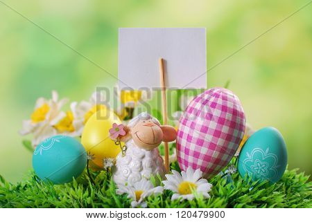 Easter Card With Cute Lamb And Eggs On The Grass