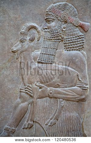 Ancient sumerian stone carving with cuneiform scripting