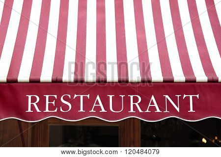 Striped French Restaurant Canopy In Paris France.