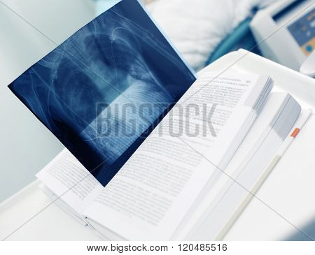 Book With An X-ray Image As A Bookmark In Hospital, Concept Of Theory And Practice