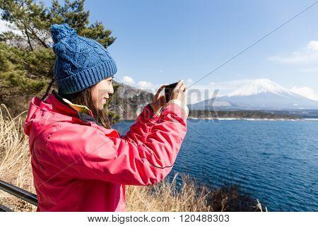 Woman take the photo on Fujisan