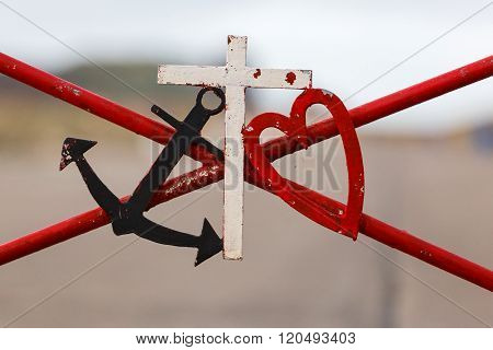 Symbolic black marine anchor red heart and white cross