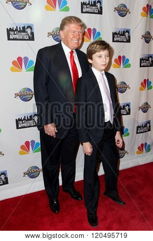 NEW YORK-FEB 16: Donald Trump (L) and son Barron  Trump attend 'The Celebrity Apprentice' finale at Trump Tower on February 16, 2015 in New York City.