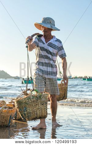 Fishermen carrying fish in the sea the morning
