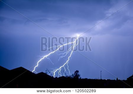Cloud to Ground forked Lightning Strike in night sky