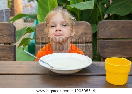 Upset Five Year Old Girl Poses Faces Unwilling To Eat Porridge For Breakfast