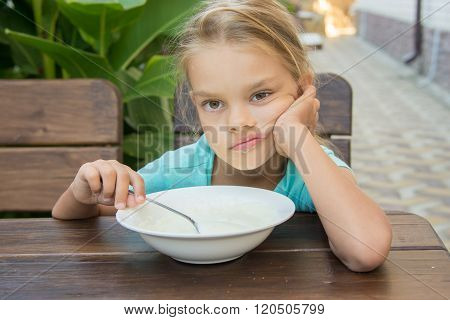 Six Year Old Girl Does Not Want To Eat Porridge For Breakfast