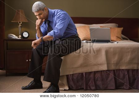 Businessman checking the time in his hotel room