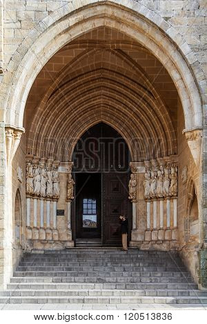 Evora, Portugal - December 1, 2015: Gothic portal of the Evora Cathedral or See, the largest cathedral in Portugal. Romanesque and Gothic architecture. UNESCO World Heritage Site.