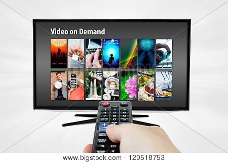 Video on demand VOD service on smart TV. Remote control in hand. poster