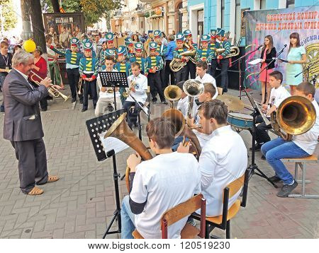 Conductor And His Brass Band Of Pupils