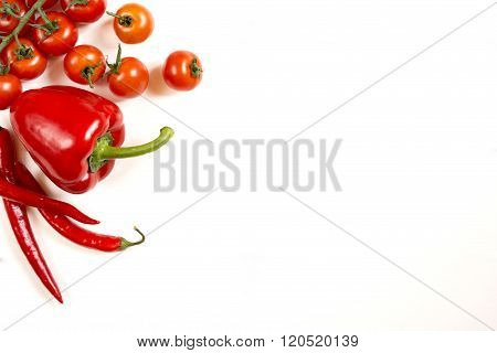 Tomatoes red pepper  on a white white background free space top view