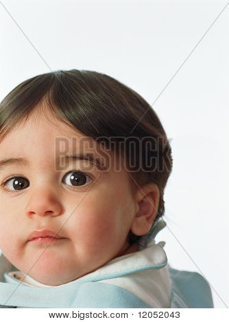Close up of toddler girl with big eyes
