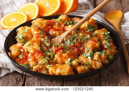 Chicken In Sweet And Sour Orange Sauce Closeup. Horizontal