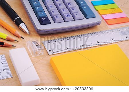 Office table desk with set of Office Stationery or Math Supplies.
