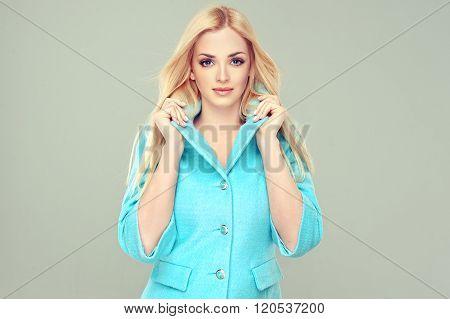 Beautiful model blonde in the blue coat