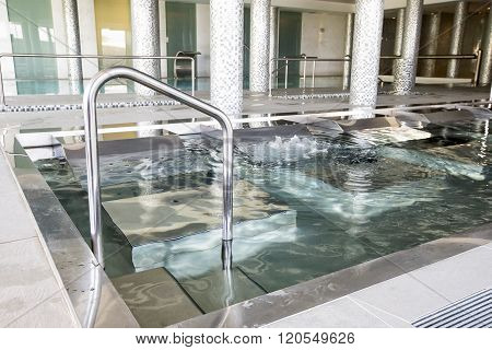 Empty Interior Swimming Pool With Relaxation Area.