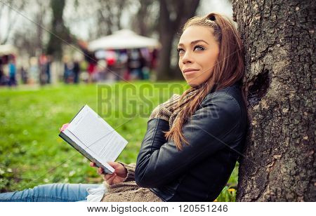 Young woman reading book