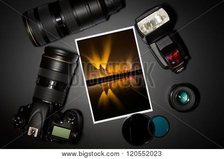 Camera Lens And Image On Black Background