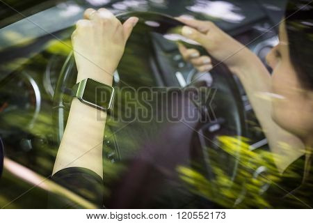 A Woman Uses Smartwatch In The Car.