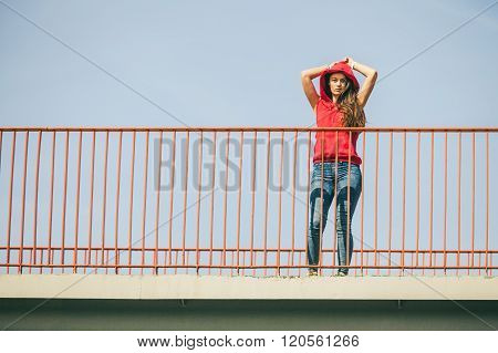 Girl On Bridge In City.