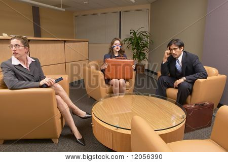 Businesspeople sitting in waiting room
