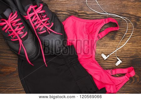 Sneakers, Shorts And Sports Bra, Wooden Background