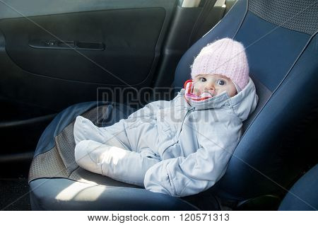 Newborn In Car Sitting On Front Seat Dressed For Winter