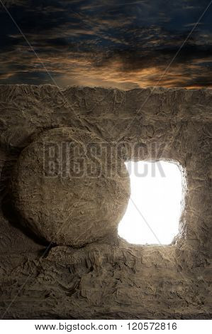 Open tomb of jesus with light coming out of opening