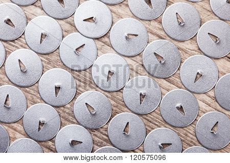 lot of pushpin top view on wooden surface macro background