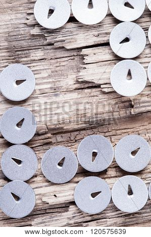 abstract background of rotten board and round hats pushpin